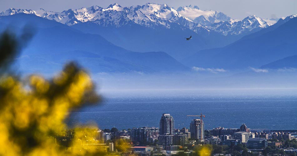 Image of Victoria in British Columbia, Canada with snow-capped mountains in the background