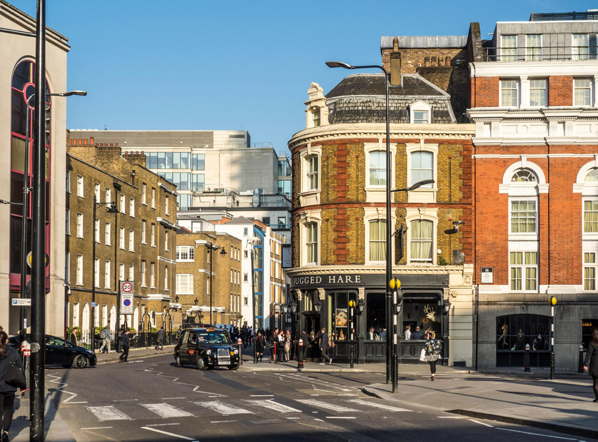 Image of pedestrian crossing on Beech Street towards Chiswell Street with The Jugged Hare pub / gastropub, in City of London, UK