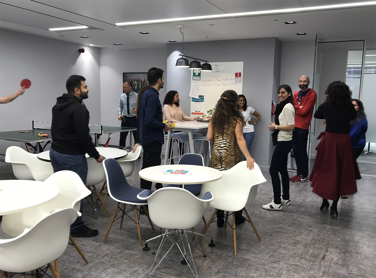 An image of employees engaging with each other in a shared space