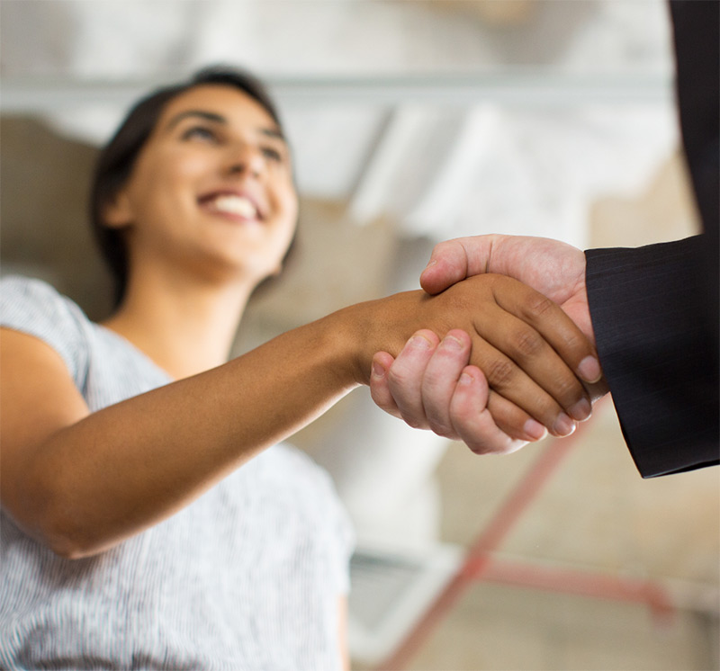 A man and a woman shaking hands to illustrate process